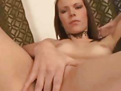 The lovely young girl rubs her clit gently