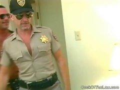Older cop sucks off a hung beefy bear