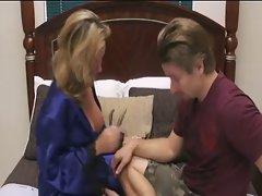 Milf teaches boy how to pleasure a girl