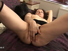 Horny amateur housewife playing with her wet pussy