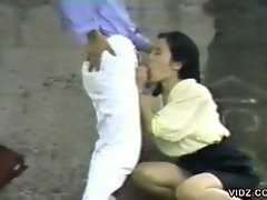 Sexy asian bitch gives man blowjob outdoors