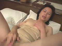 Horny mature japanese babe masturbating on camera