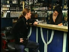 Double dick sucking in a bar