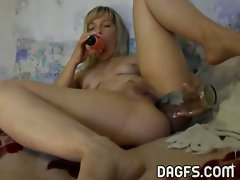 Blonde cutie licks her dildo and stuffs it in her pussy