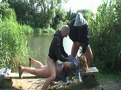 Pissing granny gets raped by two horny dudes outdoors