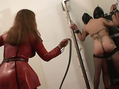 Two masked maidens at the mercy of their mistress