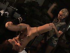 Brunette slave tortured by her blonde mistress