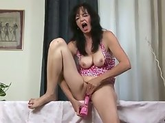 Horny milf masturbates at home