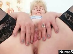 Aged blonde lady shows off natural tits and dildo skills