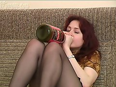 Olga likes drinking and smoking and she's doing both in this hot...