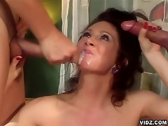 This hot and horny Milf Ray Vaness gets her hands on two big cocks....