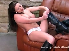 Candi puts on a gorgeous pair of leather boots nice and slowly for...