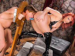 Nicki Hunter does her work in a dark dungeon with her dildo...