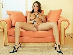 Evelin couldn't be happier with a dildo crammed into her hole. She's...