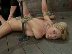 Flexible Blond MILF is tied in the splits.  Toes tied with bailing...