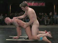 Two naked athletes fight and have sex in front of a live audience!...