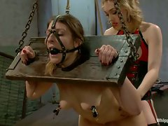 Youthful lesbian domme dominates older women by over the knee...