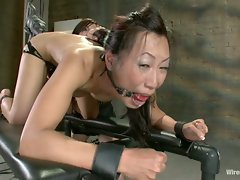 Tia Ling fucked hard in the ass with electricity pulsing through her...