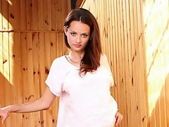 Leggy brunette Nubile Vally is a teen with a stunning face and a...