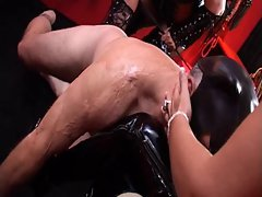 Mistresses get their boots worshiped