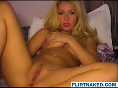 Sexy blonde playing with her juicy cunt
