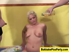 Watersports fetish slut showered in piss