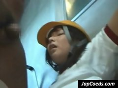 Asian coed sucking two shafts
