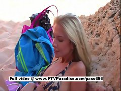 Lovely Blonde girl fingering pussy on a public beach