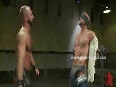 Large whips torment gay hunks bound