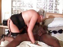 Attractive grandma loves riding a big black