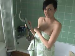 Short haired doll in bathroom
