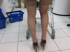 Girlie in blue dress and tan stockings in supermarket 2