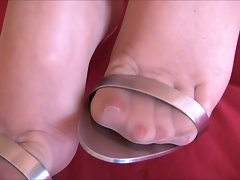 Sexual feet in metal heels