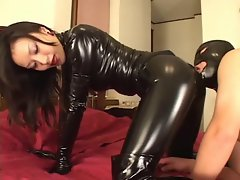 Mistress Reiko in sexual catsuit with her slave