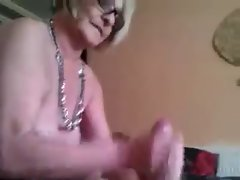 Big breasted granny jerks off a chap
