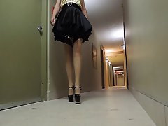 Sissy Ray in hotel corridor wearing maids uniform