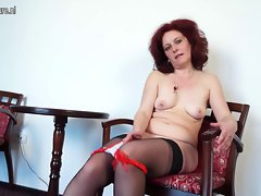 Attractive mature nympho stepmom masturbating in a chair