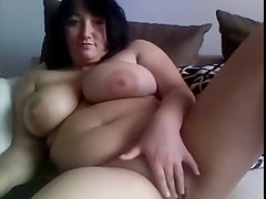 big buxom Mum masturbates on webcam