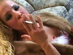 Sexy smoking hottie pleasuring in fur