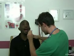 Sweet doctor guy examines patient Jackson
