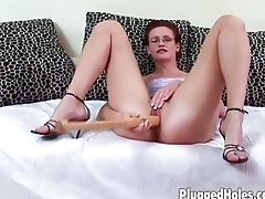 Redhead puts dildo deep inside her cunt