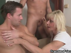 She gets pleased by two hung hunks.