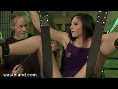 Brunette gets suspended while master tortures her