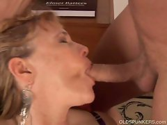 Hot milf gives a lesson on how to suck a young cock