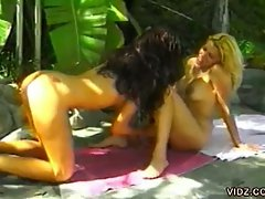 Perfect lesbian beauties lick pussy in the backyard