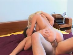 Busty blonde making love with her boyfriend
