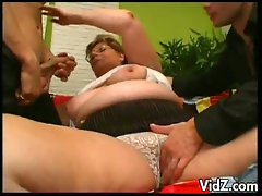 Nasty grandma gets throat and bush fucked in hot threesome