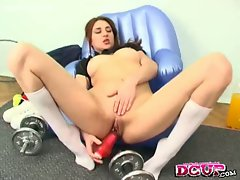 Christine works out her pussy with a big dildo