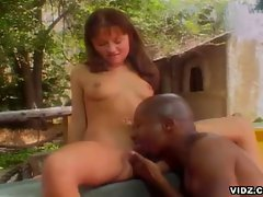 Young brunette gets excited to see monster black cock outdoors