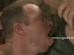 Gay man dressed in leather in bondage officer whipping and spanki